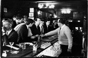 After pouring their drinks, a bartender in Julius's Bar refuses to serve John Timmins, Dick Leitsch, Craig Rodwell (1940 - 1993), and Randy Wicker, members of the Mattachine Society, an early American gay rights group, who were protesting New York liquor laws that prevented serving gay customers, New York, New York, April 21, 1966. (Photo by Fred W. McDarrah/Getty Images)
